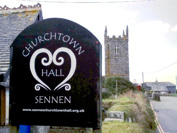 view of the Sennen hall and church on the A30