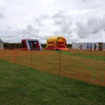 Marquee and bouncy castle in Sennen field